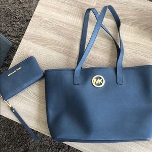 Michael Kors tote and matching wristlet wallet.